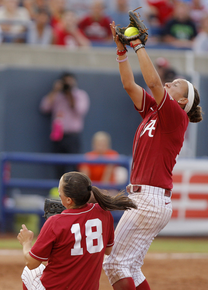Alabama's Kaila Hunt (10) catches the ball over Cassie Reilly-Boccia (18) in the third inning during the championship game of the Women's College World Series as ASA Stadium in Oklahoma City, Tuesday, June 5, 2012. Photo by Bryan Terry, The Oklahoman