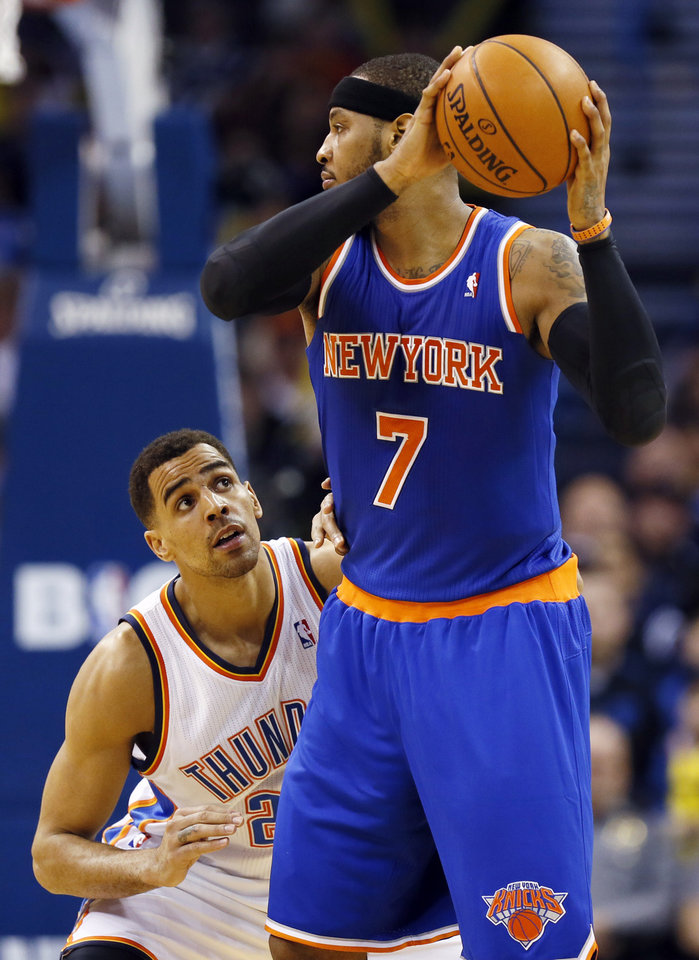Oklahoma City\'s Thabo Sefolosha (25) defends New York\'s Carmelo Anthony (7) during an NBA basketball game between the New York Knicks and the Oklahoma City Thunder at Chesapeake Energy Arena in Oklahoma City, Sunday, Feb. 9, 2014. Photo by Nate Billings, The Oklahoman