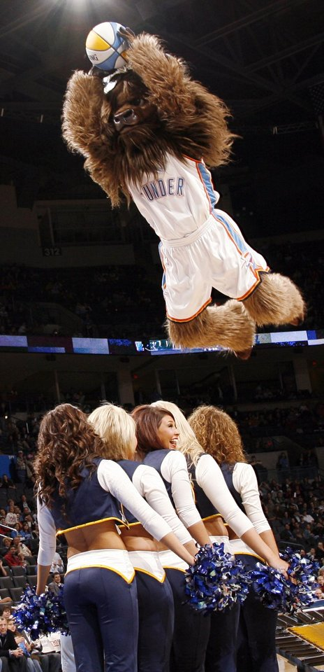 Oklahoma City mascot Rumble the Bison dunks the ball over a group of Thunder girls during the NBA preseason game between the Sacramento Kings and the Oklahoma City Thunder at the Ford Center in Oklahoma City, Thursday, Oct. 22, 2009. Photo by Nate Billings, The Oklahoman