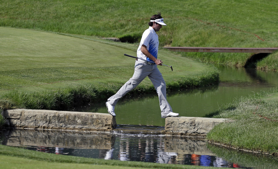 Photo - Bubba Watson walks to the 14th green during the third round of the Memorial golf tournament Saturday, May 31, 2014, in Dublin, Ohio. (AP Photo/Darron Cummings)