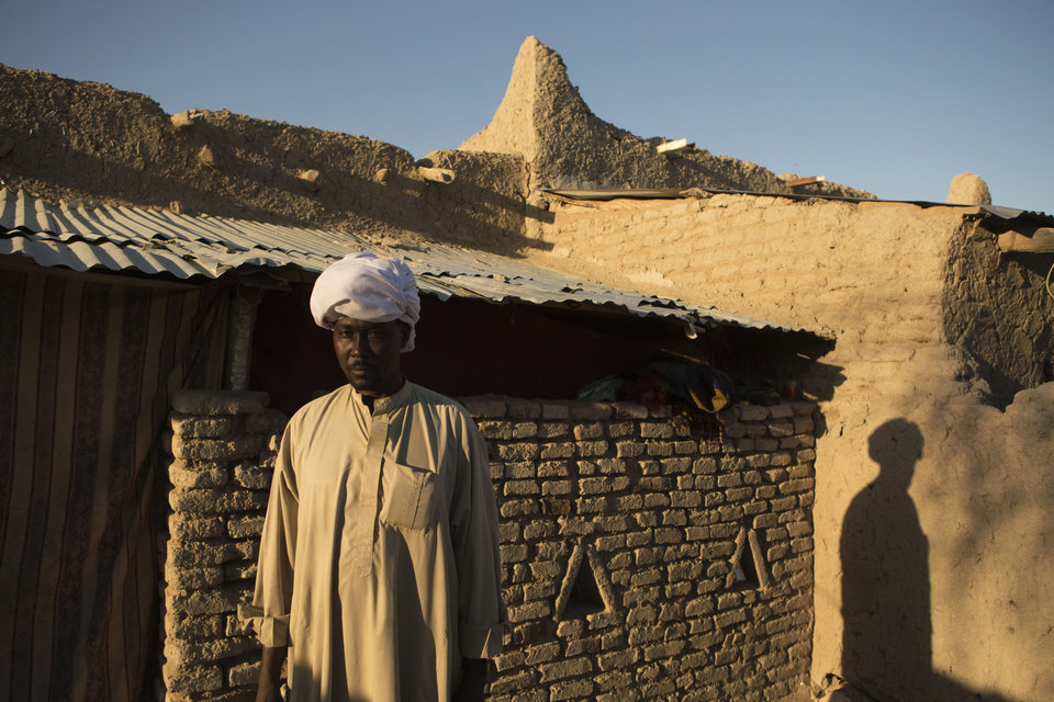 ADVANCE FOR SATURDAY DEC 22, 2012  - In this Nov. 4, 2012 photo, traditional healer Hakki Hassan poses for a picture in front of his home in Moussoro, Chad. In this Sahel nation, childhood malnutrition and related mortality persist at alarming rates, despite the fact that most affected families live within a day's journey of internationally-funded nutrition clinics. One reason is that families, bound by local custom, choose instead to seek traditional treatments, treatments which can lead to the very infections that kill their undernourished children.(AP Photo/Rebecca Blackwell)