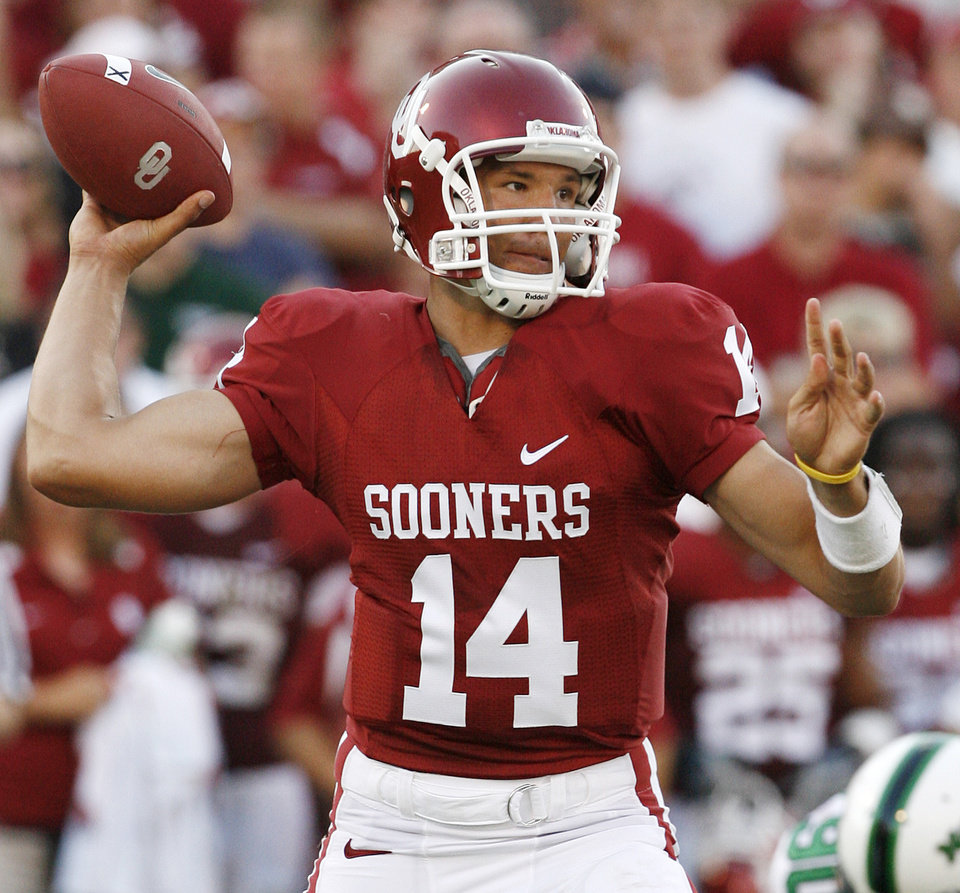 Photo - Oklahoma quarterback Sam Bradford (14) throws the ball in the first half during the University of Oklahoma Sooners (OU) college football game against the University of North Texas Mean Green (UNT) at the Gaylord Family -- Oklahoma Memorial Stadium, on Saturday, Sept. 1, 2007, in Norman, Okla.   By STEVE SISNEY, The Oklahoman  ORG XMIT: KOD