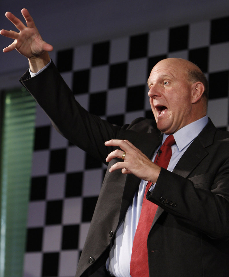 Photo - FILE - In this Oct. 7, 2009 file photo, then Microsoft CEO Steve Ballmer gestures during a news conference in Munich, southern Germany. For decades, Ballmer has been Microsoft's biggest cheerleader with his big, booming voice and energetic high-fives, which are famous around Seattle. Now that he's agreed to buy the Los Angeles Clippers for $2 billion, the former CEO of the technology giant is expected to bring that boosterism to the hardwood down south. (AP Photo/Matthias Schrader, File)