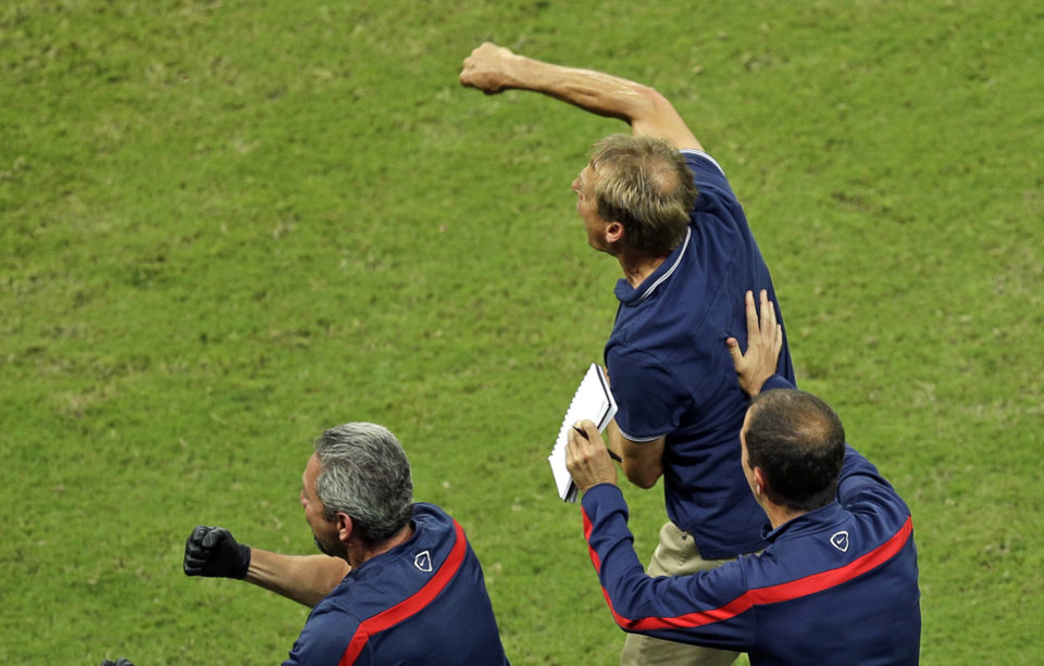Photo - United States' head coach Juergen Klinsmann celebrates after Jermaine Jones scored his side's first goal during the group G World Cup soccer match between the USA and Portugal at the Arena da Amazonia in Manaus, Brazil, Sunday, June 22, 2014. (AP Photo/Themba Hadebe)