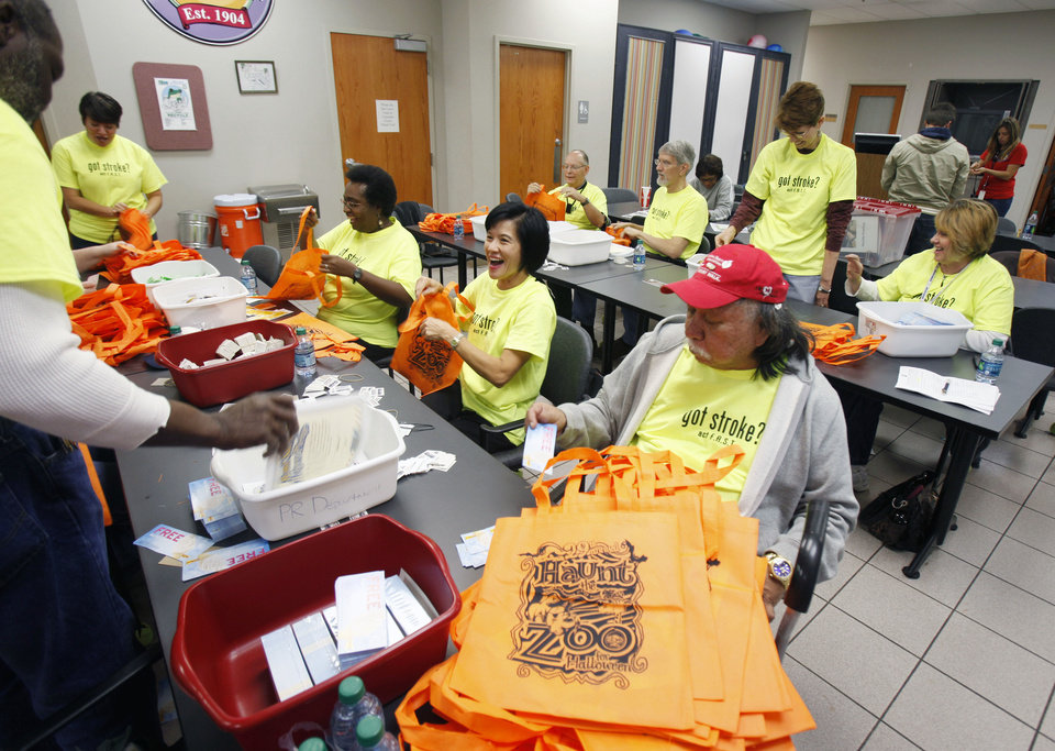 Photo - Volunteers stuff bags in preparation for Haunt the Zoo at the Oklahoma City Zoo. The five-day event starts Friday.  Photo by Paul Hellstern, The Oklahoman  PAUL HELLSTERN
