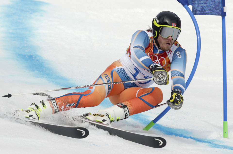 Photo - Norway's Kjetil Jansrud passes a gate in the first run of the men's giant slalom at the Sochi 2014 Winter Olympics, Wednesday, Feb. 19, 2014, in Krasnaya Polyana, Russia. (AP Photo/Charles Krupa)