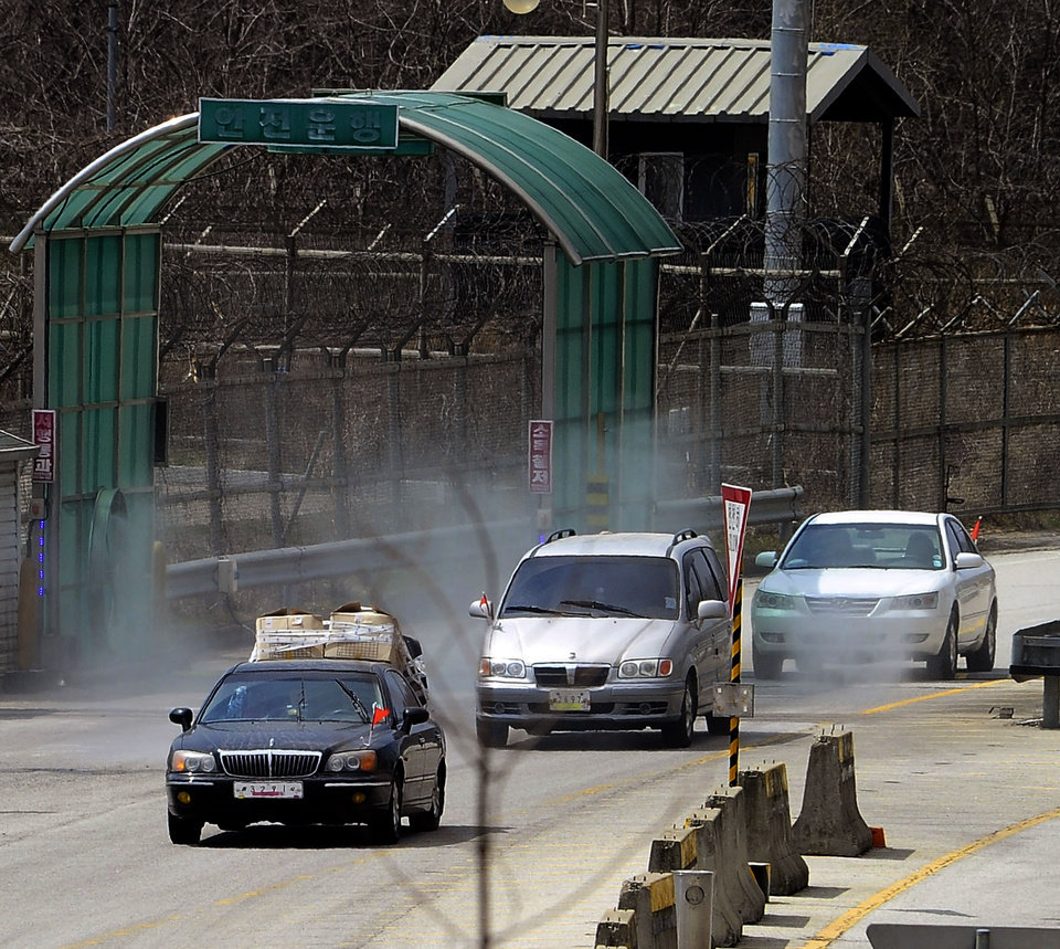 Photo - South Korean vehicles, returnning from the North Korean city of Kaesong,  arrive at the customs, immigration and quarantine office near the border village of Panmunjom, in Paju, north of Seoul, South Korea, Tuesday, April 9, 2013. North Korean workers didn't show up for work at the Kaesong industrial complex, a jointly run factory with South Korea on Tuesday, a day after Pyongyang suspended operations at the last remaining major economic link between rivals locked in an increasingly hostile relationship. (AP Photo/Kyodo News) JAPAN OUT, MANDATORY CREDIT, NO LICENSING IN CHINA, HONG KONG, JAPAN, SOUTH KOREA AND FRANCE
