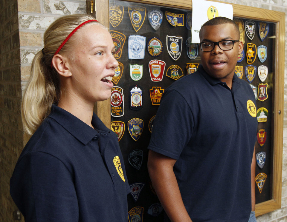 Photo - Students Bailey Harper and Christopher Plunkett  discuss their experiences as they and other students take part in the Oklahoma City Student Police Academy. Photo by Paul Hellstern, The Oklahoman  PAUL HELLSTERN - Oklahoman