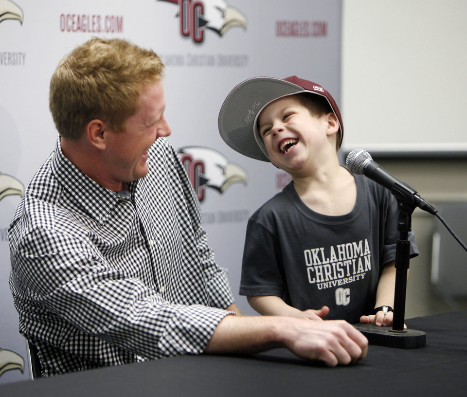 Former Oklahoma State University (OSU) college football quarterback Brandon Weeden and Gavin Kuykendall speak at a press conference for the Oklahoma Christian baseball team in Oklahoma City, OK, Friday, February 8, 2013,  By Paul Hellstern, The Oklahoman