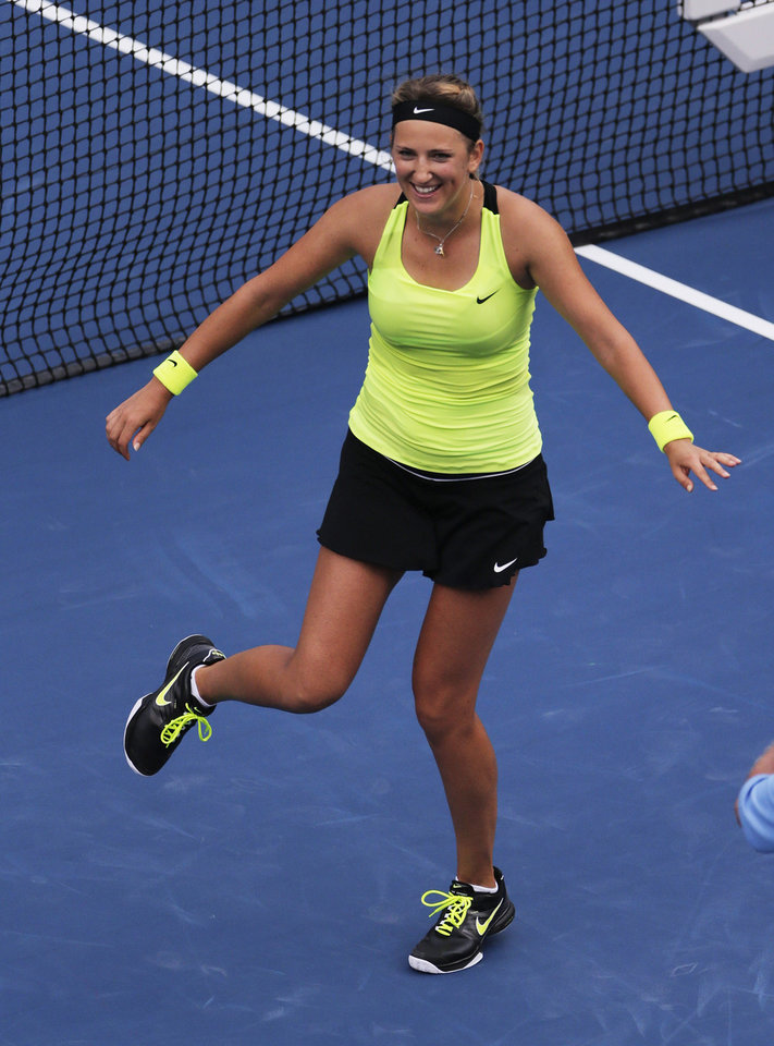 Photo -   Victoria Azarenka of Belarus dances while celebrating winning a semifinal match against Maria Sharapova, of Russia, at the 2012 US Open tennis tournament, Friday, Sept. 7, 2012, in New York. (AP Photo/Charles Krupa)