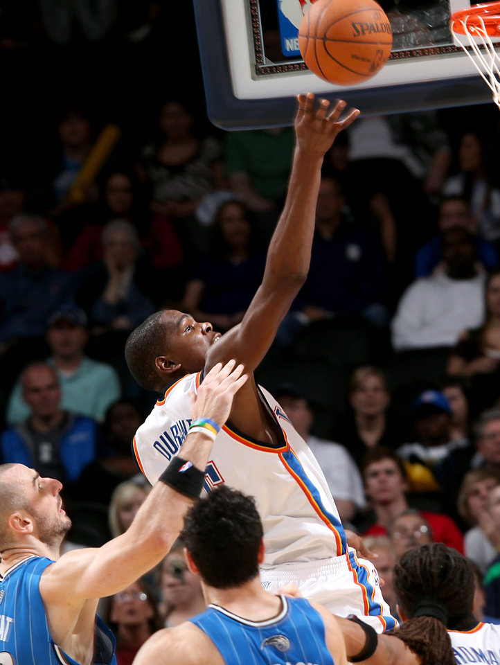Photo - Oklahoma City's Kevin Durant puts up a shot in front of Orlando's defense  during the NBA basketball game between the Orlando Magic and the Oklahoma City Thunder at the Ford Center in Oklahoma City, on Sunday, Nov. 8, 2009. The Thunder beat the Magic 102-74. By John Clanton, The Oklahoman