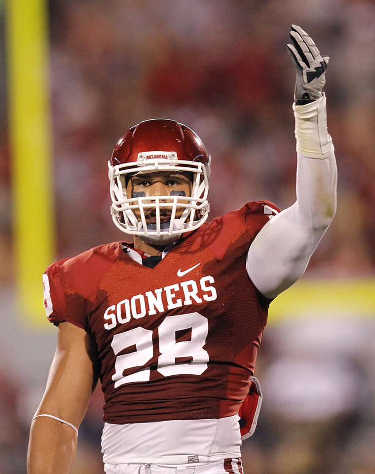 Photo - Oklahoma's Travis Lewis (28) pumps up the crowd during the college football game between the University of Oklahoma Sooners (OU) and the University of Missouri Tigers (MU) at the Gaylord Family-Memorial Stadium on Saturday, Sept. 24, 2011, in Norman, Okla. Photo by Chris Landsberger, The Oklahoman