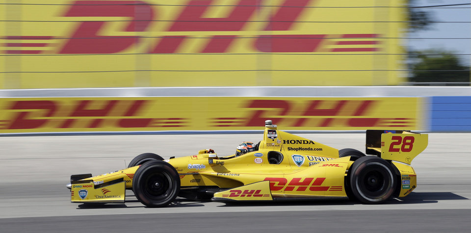 Photo - Ryan Hunter-Reay makes his way through Turn 4 during the Milwaukee Mile IndyCar auto race Sunday, Aug. 17, 2014, in West Allis, Wis. (AP Photo/Morry Gash)