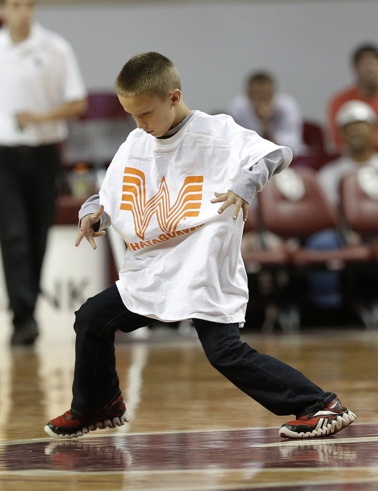 Photo - Conner Attebery dances during a timeout in a men's college basketball game between the University of Oklahoma and the University of Louisiana-Monroe at the Loyd Noble Center in Norman, Okla., Sunday, Nov. 11, 2012.  Photo by Garett Fisbeck, The Oklahoman