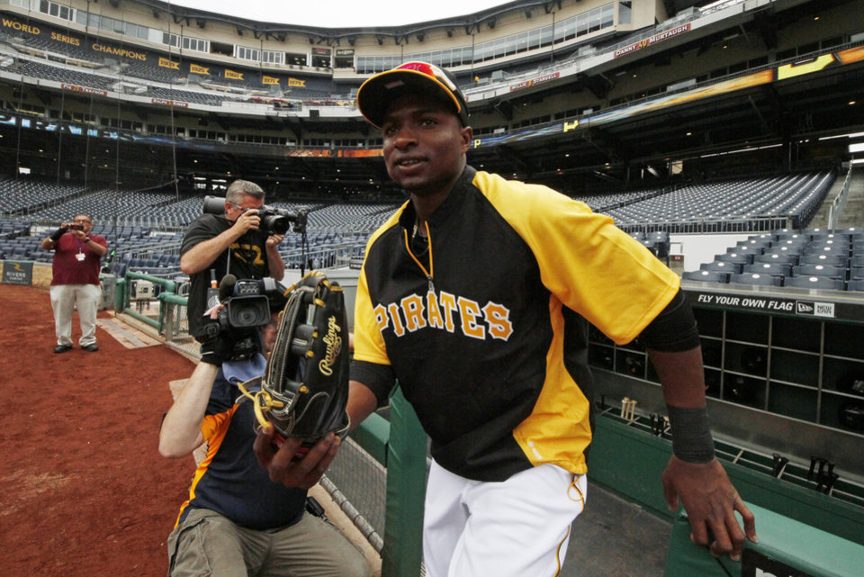 Photo - Pittsburgh Pirates' Gregory Polanco takes the field for warm ups before a baseball game against the Chicago Cubs in Pittsburgh Tuesday, June 10, 2014. It will be Polanco's Major League debut. (AP Photo/Gene J. Puskar)