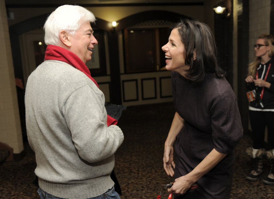 Photo - Christopher Dodd, left, chairman and CEO of the Motion Picture Association of America, greets Alexandra Pelosi, director of HBO Documentary Films'