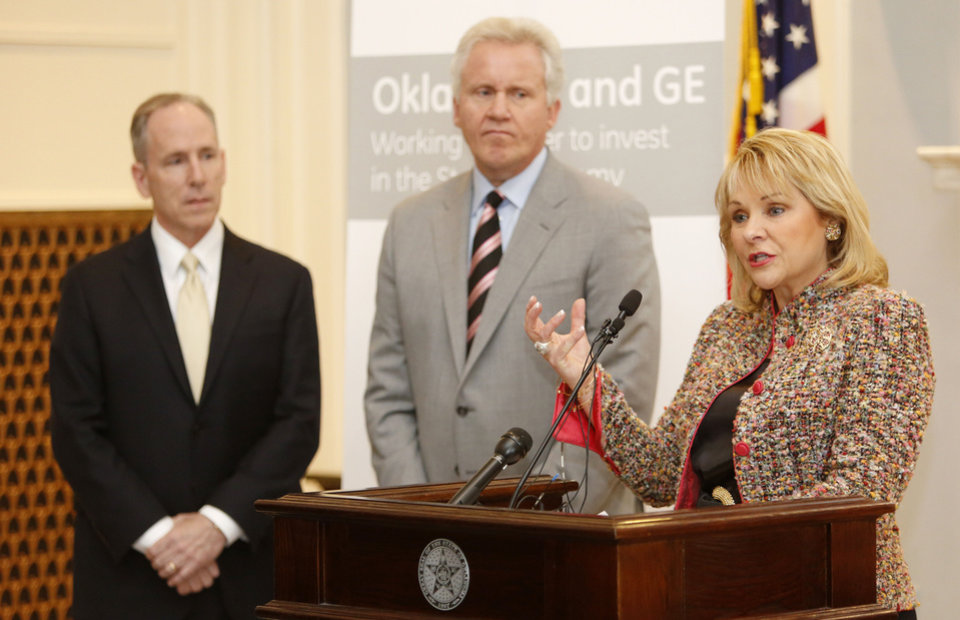 Photo - General Electric Senior Vice President and Chief Technology Officer Mark Little, left, Jeff Immelt, GE Chairman and CEO, joined Governor Mary Fallin to announce that GE will build a $110 million global research center in Oklahoma dedicated to driving innovation and technological advancements in the oil and natural gas sector during a press conference at the State Capitol in Oklahoma City , Wednesday April 3, 2013. Photo By Steve Gooch, The Oklahoman ORG XMIT: OKC1303121532440650
