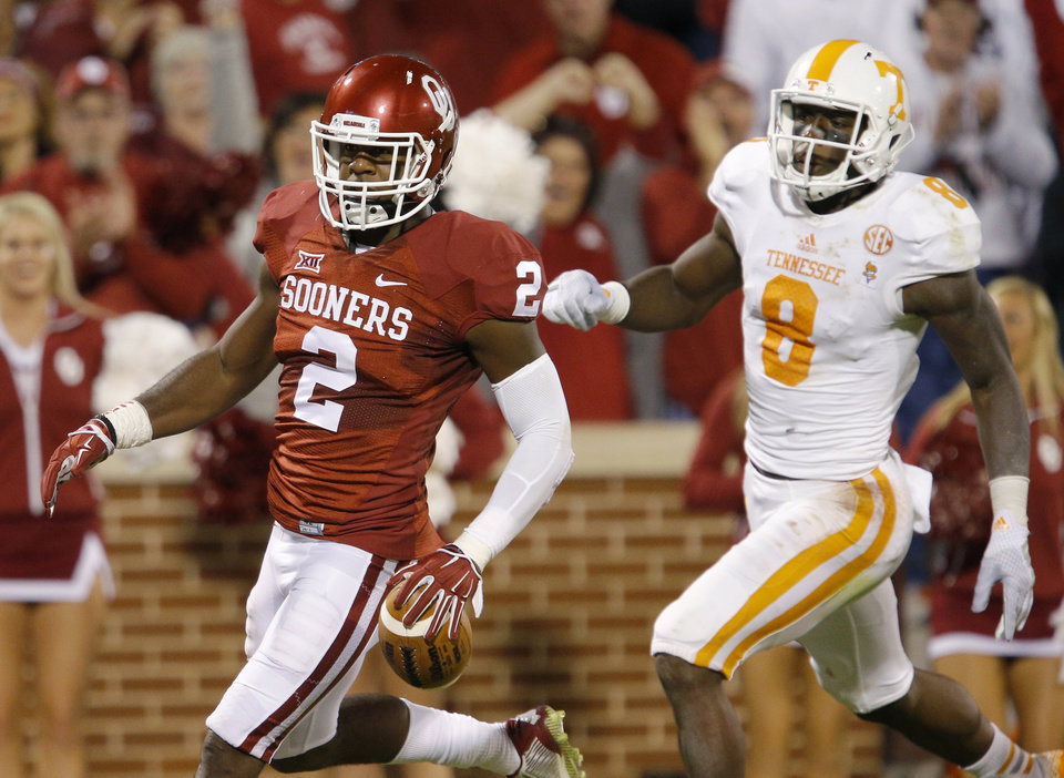 Photo - Oklahoma's Julian Wilson (2) returns an interception for a touchdown in front of Tennessee's Von Pearson (9) during a college football game between the University of Oklahoma Sooners (OU) and the Tennessee Volunteers at Gaylord Family-Oklahoma Memorial Stadium in Norman, Okla., on Saturday, Sept. 13, 2014. Photo by Bryan Terry, The Oklahoman