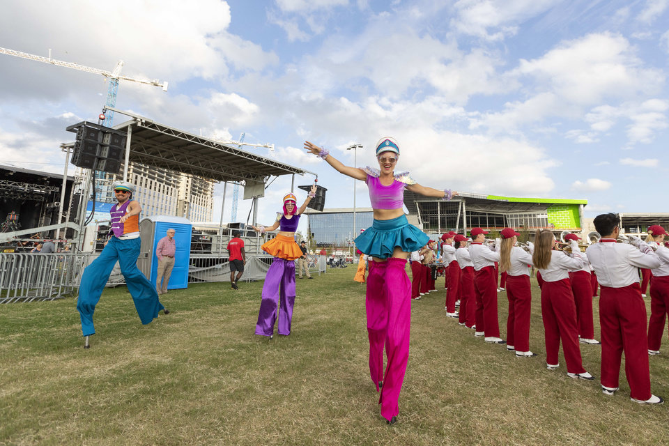 Photo - Members of Inspyral Circus perform behind the Pride of Oklahoma during the grand opening weekend of Scissortail Park in Oklahoma City, Sunday, Sept. 29, 2019. (Alonzo Adams for The Oklahoman)