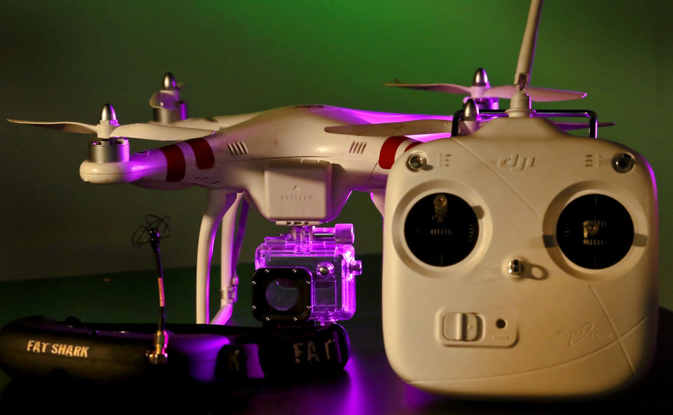 Photo -  A small quadrocopter drone by DJI Innovations armed with a GoPro video camera is pictured. [Photo by Chris Landsberger, The Oklahoman]