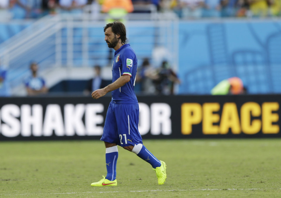 Photo - Italy's Andrea Pirlo walks off the pitch after their 1-0 loss to Uruguay during the group D World Cup soccer match at the Arena das Dunas in Natal, Brazil, Tuesday, June 24, 2014. (AP Photo/Ricardo Mazalan)