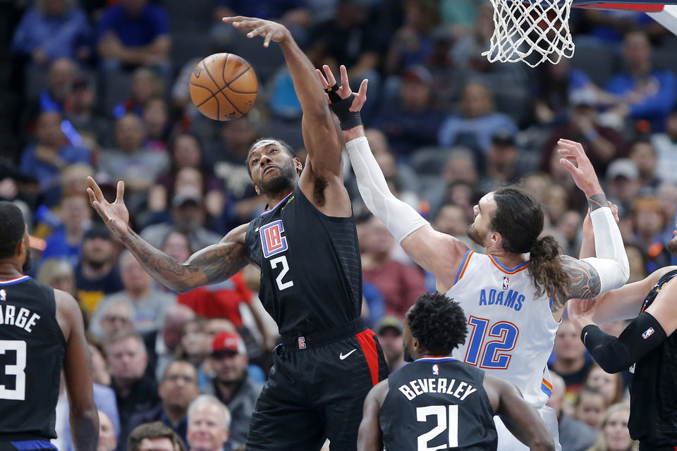 Photo - LA's Kawhi Leonard (2) gets a rebound beside Oklahoma City's Steven Adams (12) during an NBA basketball game between the Oklahoma City Thunder and the Los Angeles Clippers at Chesapeake Energy Arena in Oklahoma City, Tuesday, March 3, 2020. [Bryan Terry/The Oklahoman]