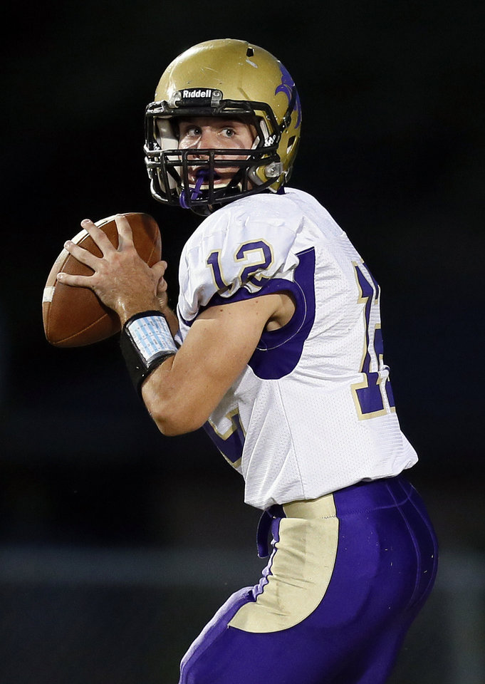 Chickasha's Cade Morris (12) looks to pass during a high school football game between Chickasha and Capitol Hill at Star Spencer's Carl Twidwell Stadium in Spencer, Okla., Thursday, Oct. 3, 2013. Photo by Nate Billings, The Oklahoman