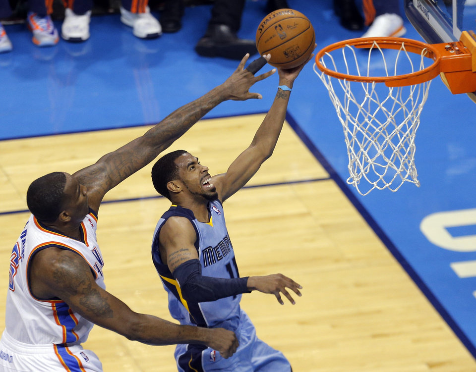 Photo - Oklahoma City's Kendrick Perkins (5) defends Memphis' Mike Conley (11) as he shoots a basket during Game 2 in the first round of the NBA playoffs between the Oklahoma City Thunder and the Memphis Grizzlies at Chesapeake Energy Arena in Oklahoma City, Monday, April 21, 2014. Photo by Sarah Phipps, The Oklahoman