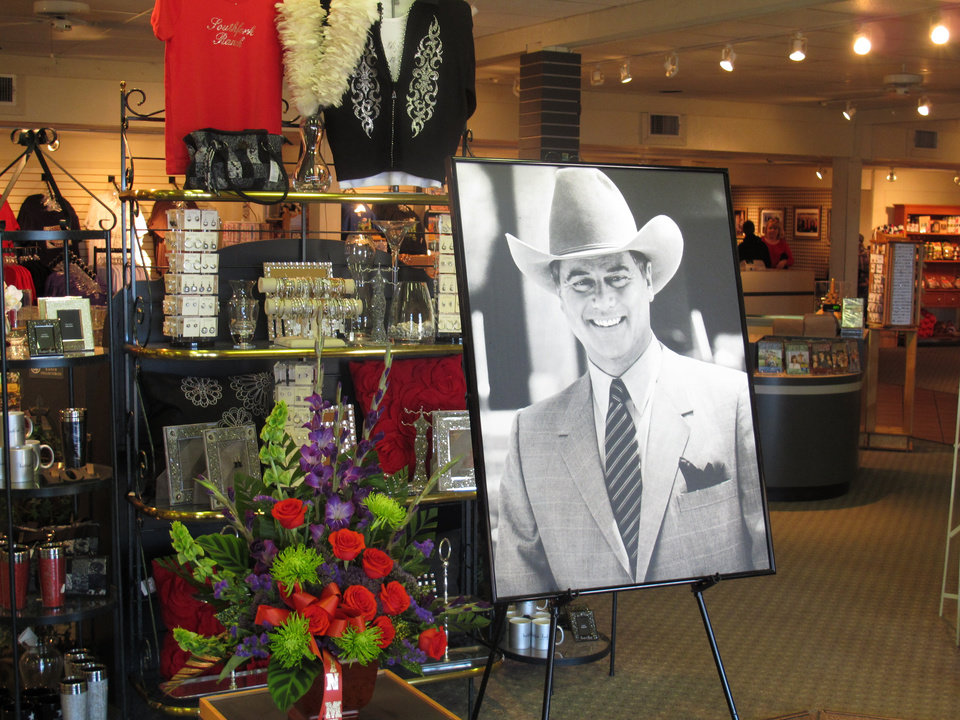 Photo -   A large portrait of Larry Hagman can be seen by a bouquet of flowers at the entrance of the gift shop at Southfork Ranch on Saturday, Nov. 24, 2012, in Parker, Texas. Officials at the ranch, the setting for the TV series
