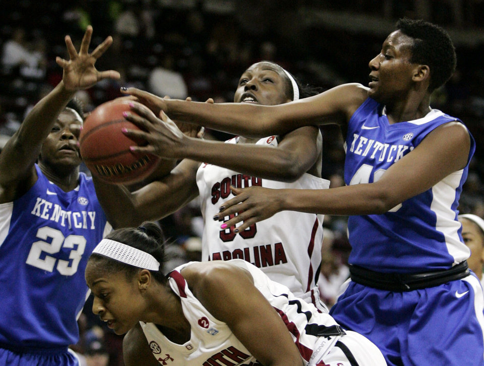 Kentucky\'s Samarie Walker (23) and Brittany Henderson (40) pressure South Carolina\'s Elem Ibiam (33) during the first half of their NCAA college basketball game, Thursday, Jan. 24, 2013, in Columbia, S.C. (AP Photo/Mary Ann Chastain)