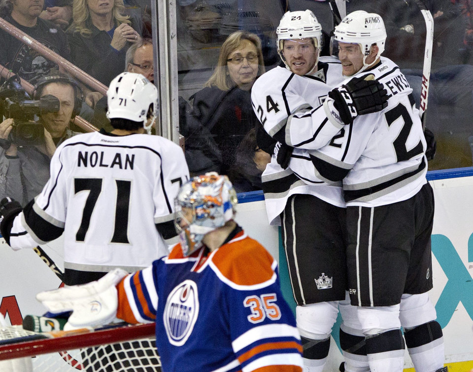 Los Angeles Kings' Jordan Nolan, 71, Colin Fraser, 24, and Trevor Lewis, 22, celebrate Fraser's goal on the Edmonton Oilers during second period NHL hockey action in Edmonton, Alberta, on Tuesday Feb. 19, 2013. (AP Photo/THE CANADIAN PRESS,Jason Franson)