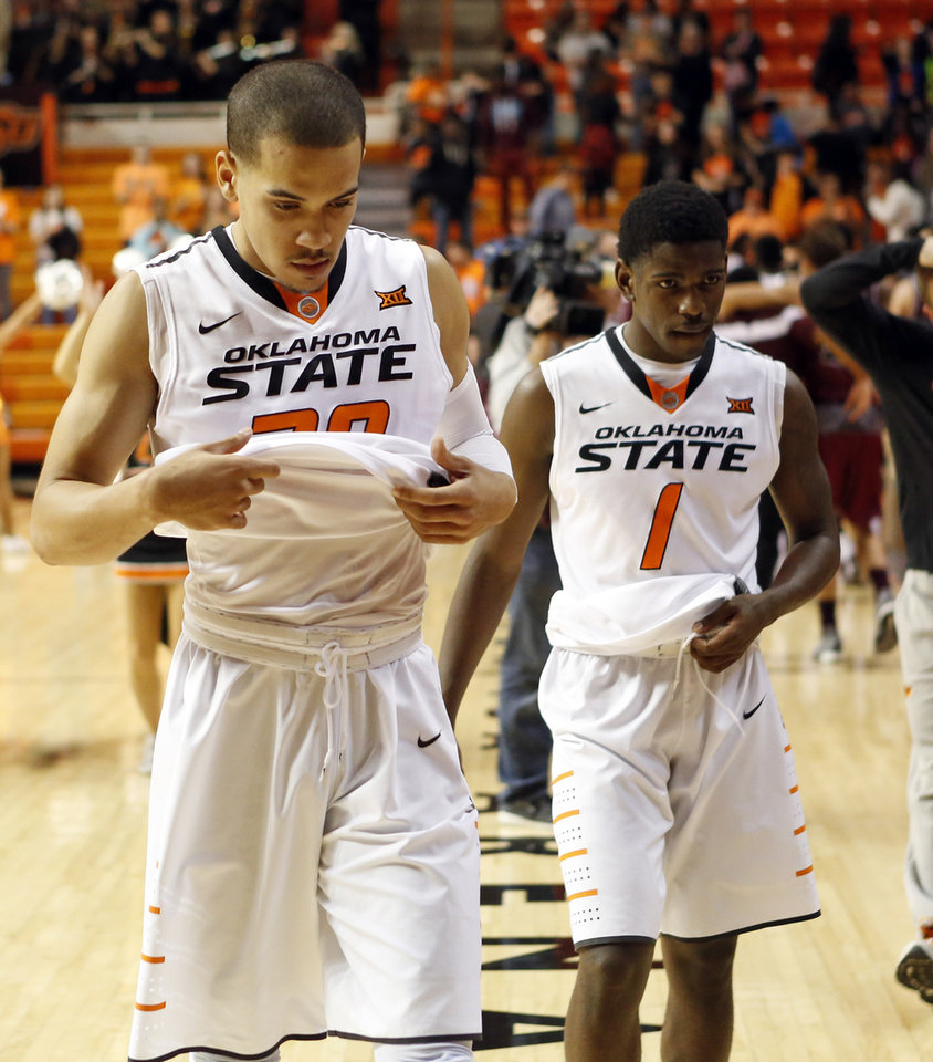 Photo - OSU's Jeffrey Carroll (30) and Jawun Evans (1) leave the court after a men's college basketball game between Oklahoma State and Missouri State at Gallagher-Iba Arena in Stillwater, Okla., Saturday, Dec. 5, 2015. Missouri State won 64-63. Photo by Nate Billings, The Oklahoman