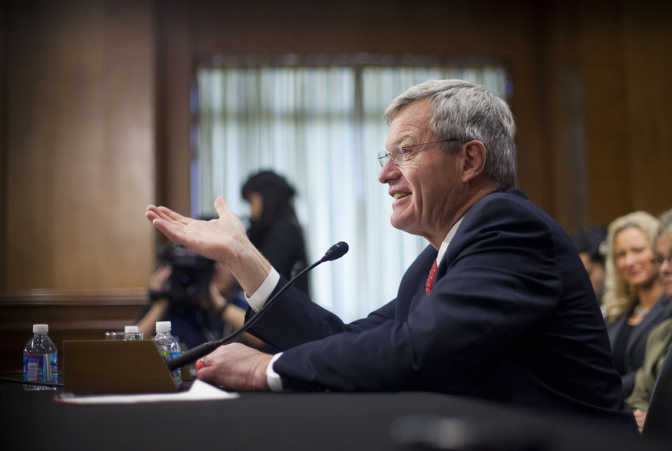 Photo - Retiring Montana Sen. Max Baucus testifies on Capitol Hill in Washington, Tuesday, Jan. 28, 2014, before the Senate Foreign Relations Committee hearing on his nomination to become US ambassador to China. Tuesday's hearing by the Senate Foreign Relations Committee was a switch for the six-term Democrat from Montana. As chairman of the Senate Finance Committee, Baucus is used to vetting nominees. On Tuesday he will be answering questions.  (AP Photo/Pablo Martinez Monsivais)