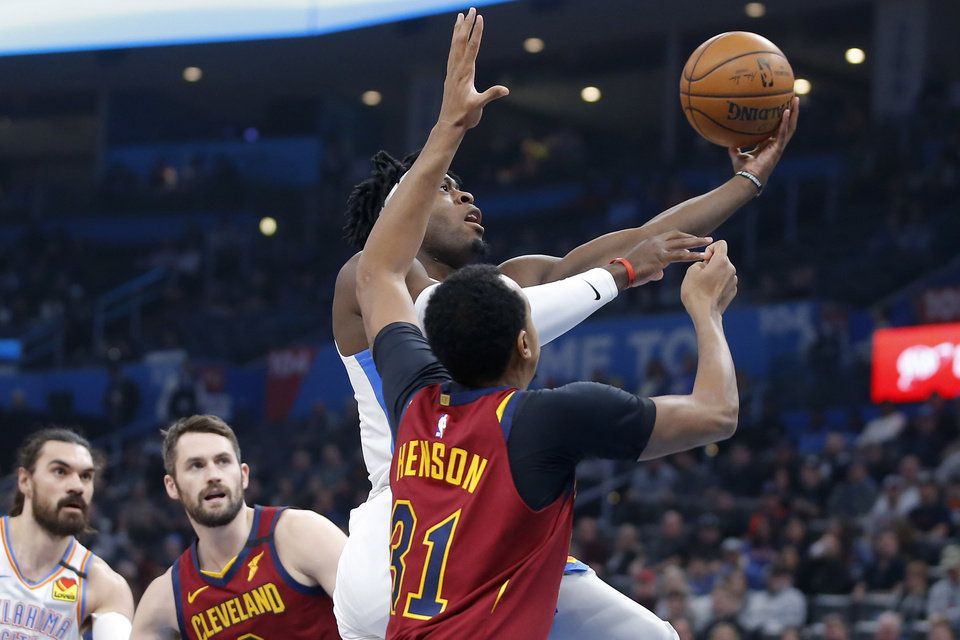 Photo - Oklahoma City's Luguentz Dort (5) goes to the basket past Cleveland's John Henson (31) during an NBA basketball game between the Oklahoma City Thunder and the Cleveland Cavaliers at Chesapeake Energy Arena in Oklahoma City, Wednesday, Feb. 5, 2020. [Bryan Terry/The Oklahoman]