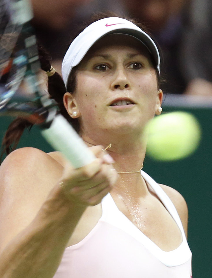 Photo -   Sweden's Sofia Arvidsson returns a ball to Denmark's Caroline Wozniacki during a semifinal match at the Kremlin Cup tennis tournament in Moscow, Russia, Saturday, Oct. 20, 2012. (AP Photo/Misha Japaridze)