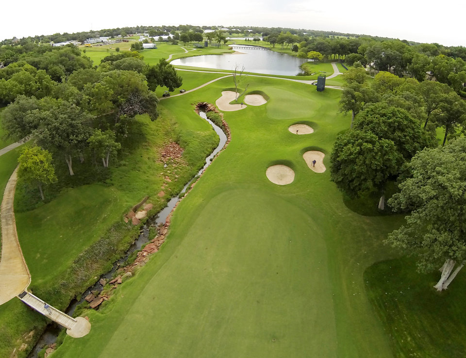 Photo - 7th green. Aerials of Oak Tree National course in Edmond, site of the 2014 U.S. Senior Open, Tuesday, July 1, 2014. Photo by Carl Shortt, Jr., for The Oklahoman