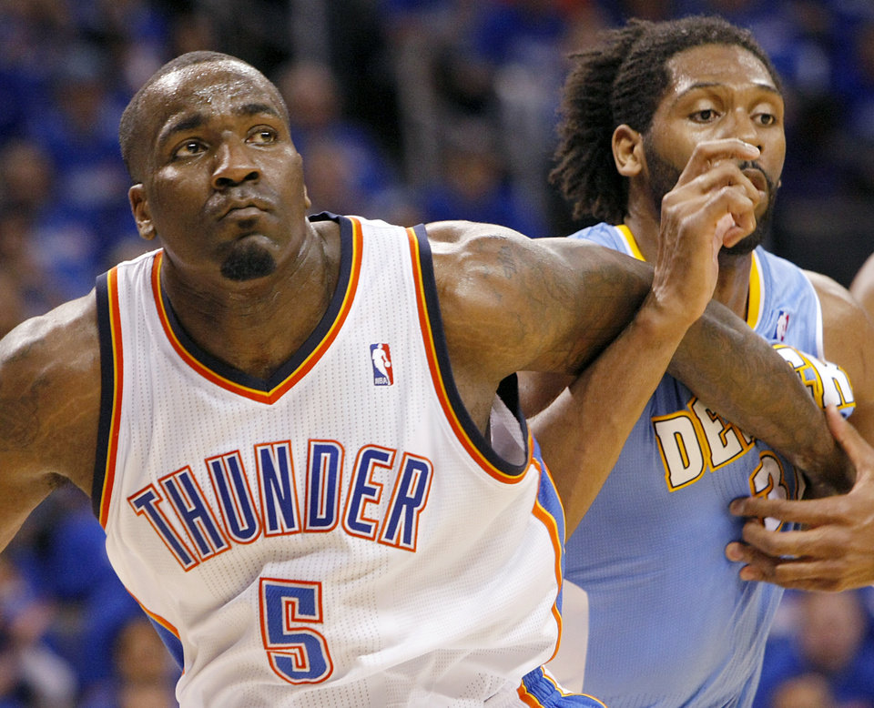 Photo - Oklahoma City's Kendrick Perkins blocks out Denver's Nene during a free throw in their first round NBA Playoff basketball game between the Thunder and the Nuggets at OKC Arena in downtown Oklahoma City on Wednesday, April 20, 2011. Photo by John Clanton, The Oklahoman