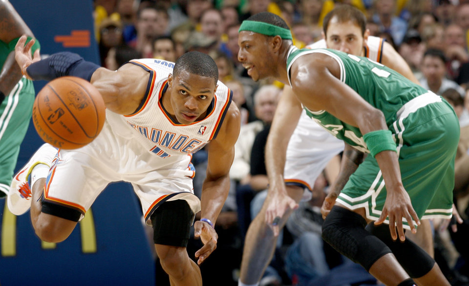 Photo - Oklahoma City's Russell Westbrook (0) grabs a loose ball in front of Boston's Paul Pierce during the NBA game between the Oklahoma City Thunder and the Boston Celtics, Sunday, Nov. 7, 2010, at the Oklahoma City Arena. Photo by Sarah Phipps, The Oklahoman