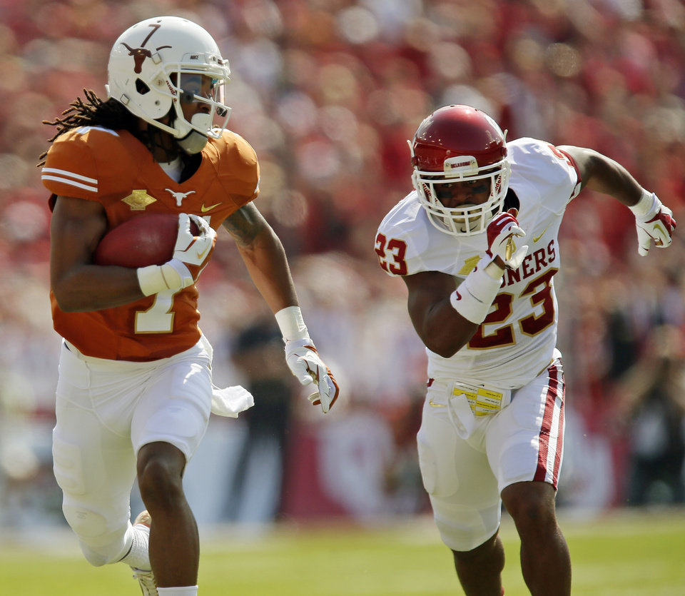 Photo - Marcus Johnson (7) runs from OU's Kass Everett (23) on a touchdown catch in the second quarter during the Red River Rivalry college football game between the University of Oklahoma Sooners and the University of Texas Longhorns at the Cotton Bowl Stadium in Dallas, Saturday, Oct. 12, 2013. Photo by Nate Billings, The Oklahoman