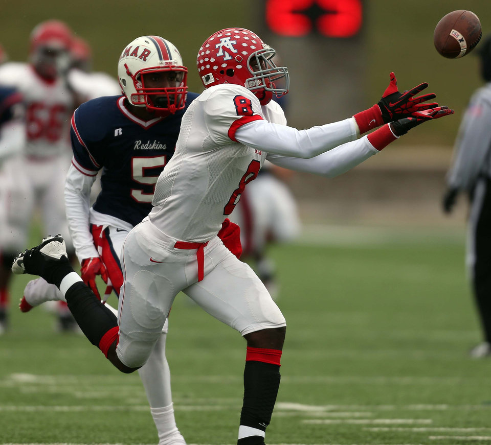 Photo - Alief Taylor's Keenen Brown (8) makes a reception past Lamar's Holton Hill during the first half of a high school football playoff game, Saturday, November 23, 2013, at Delmar Stadium in Houston. (Photo: Eric Christian Smith/For the Chronicle)