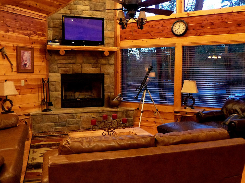 Photo - The Bella Lodge, available to rent through Broken Bow Cabin Lodging, has a luxury feel and a telescope in the living room for viewing the wildlife outside. PHOTO BY LILLIE-BETH BRINKMAN, THE OKLAHOMAN.