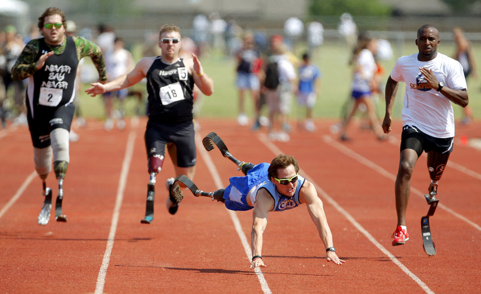 Rudy Garcia-Tolson falls down in the 100m race during the Endeavor Games at the Edmond North High School track on Saturday. June 11, 2011. Garcia-Tolson, a member of the USA Paralympic Team, got up and finished the race. Photo by Bryan Terry, The Oklahoman