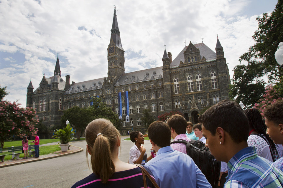 Photo - Prospective students tour Georgetown University's campus in Washington, Wednesday, July 10, 2013. The defeat of a student loan bill in the Senate on Wednesday clears the way for fresh negotiations to restore lower rates, but lawmakers are racing the clock before millions of students return to campus next month to find borrowing terms twice as high as when school let out. (AP Photo/Jacquelyn Martin)