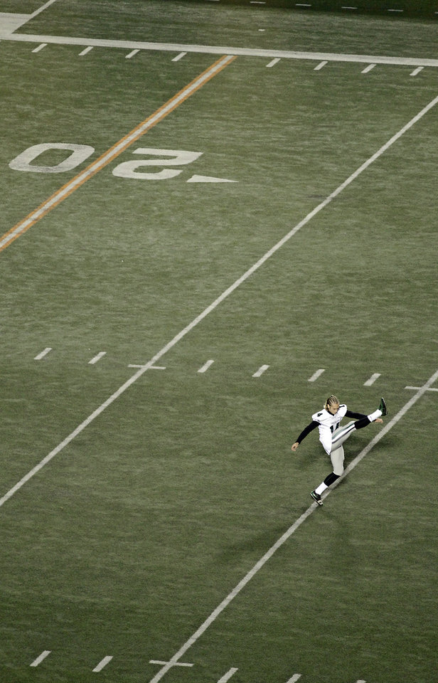 Photo - Norman North kicker Redford Jones warms up before the start of the Class 6A Oklahoma state championship football game between Norman North High School and Jenks High School at Boone Pickens Stadium on Friday, Nov. 30, 2012, in Stillwater, Okla.   Photo by Chris Landsberger, The Oklahoman