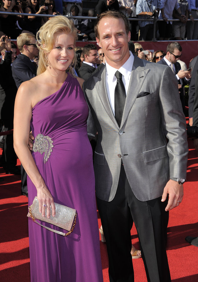 Photo -   New Orleans Saints quarterback Drew Brees, right, and Brittany Brees arrive at the ESPY Awards on Wednesday, July 11, 2012, in Los Angeles. (Photo by Chris Pizzello/Invision/AP)