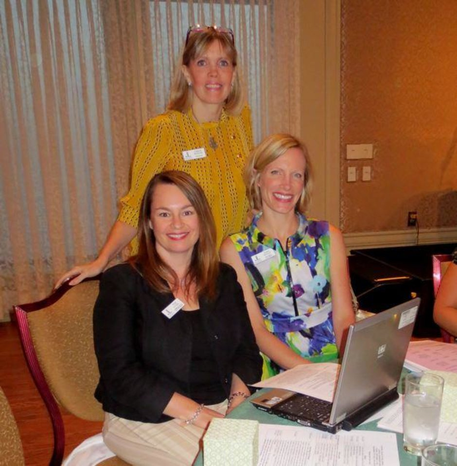 Cristi Reiger, standing, Pamela Gutel, Sara Sweet were at the meeting. (Photo by Helen Ford Wallace).
