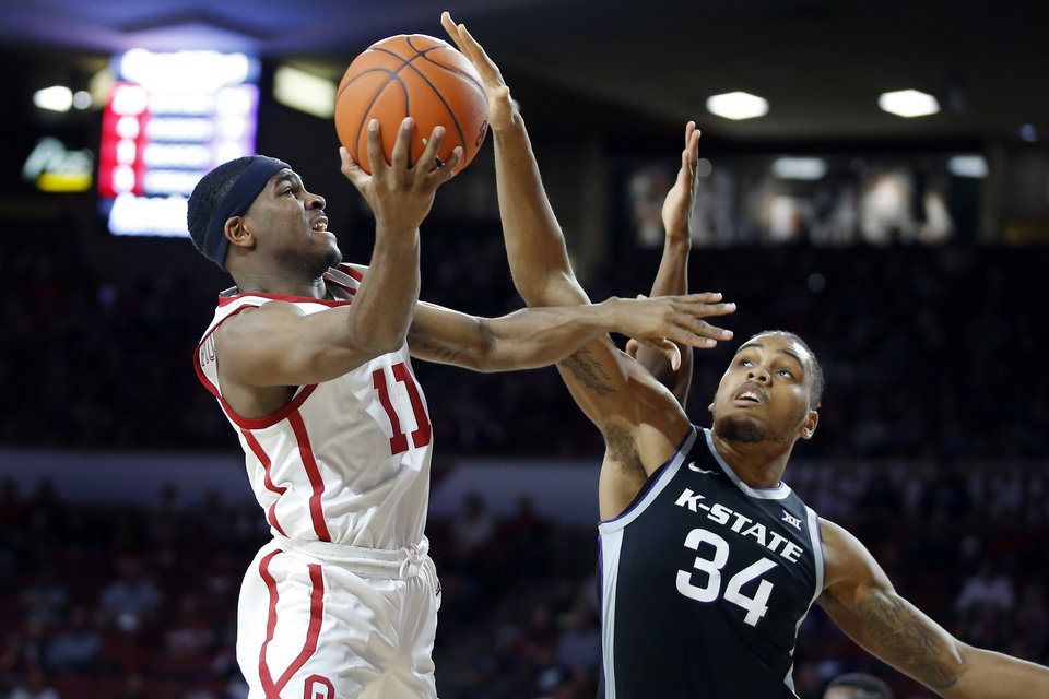 Photo - Oklahoma's De'Vion Harmon (11) puts up a shot beside Kansas State's Levi Stockard III (34) during an NCAA college basketball game between the University of Oklahoma Sooners (OU) and the Kansas State Wildcats at Lloyd Noble Center in Norman, Okla., Saturday, Jan. 4, 2020. Oklahoma won 66-61. [Bryan Terry/The Oklahoman]