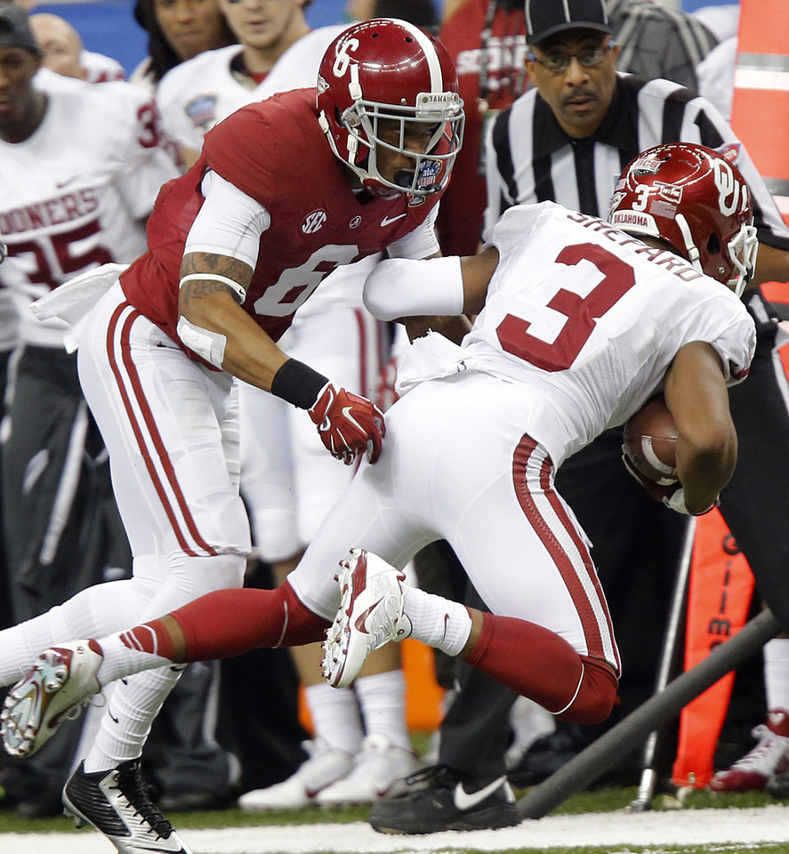 Photo - Alabama's Ha Ha Clinton-Dix (6) brings down Oklahoma's Sterling Shepard (3) during the NCAA football BCS Sugar Bowl game between the University of Oklahoma Sooners (OU) and the University of Alabama Crimson Tide (UA) at the Superdome in New Orleans, La., Thursday, Jan. 2, 2014.  .Photo by Chris Landsberger, The Oklahoman