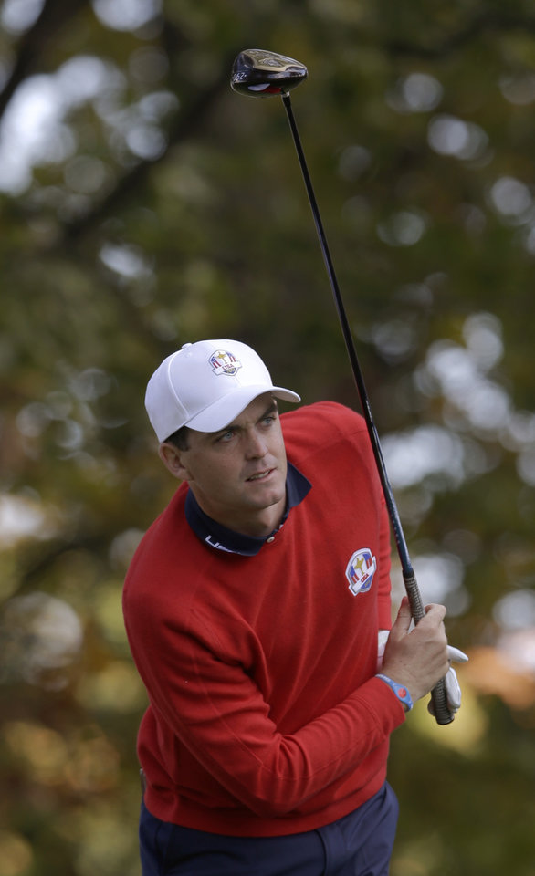 USA's Keegan Bradley watches his drive on the third hole during a singles match at the Ryder Cup PGA golf tournament Sunday, Sept. 30, 2012, at the Medinah Country Club in Medinah, Ill. (AP Photo/Chris Carlson)  ORG XMIT: PGA121