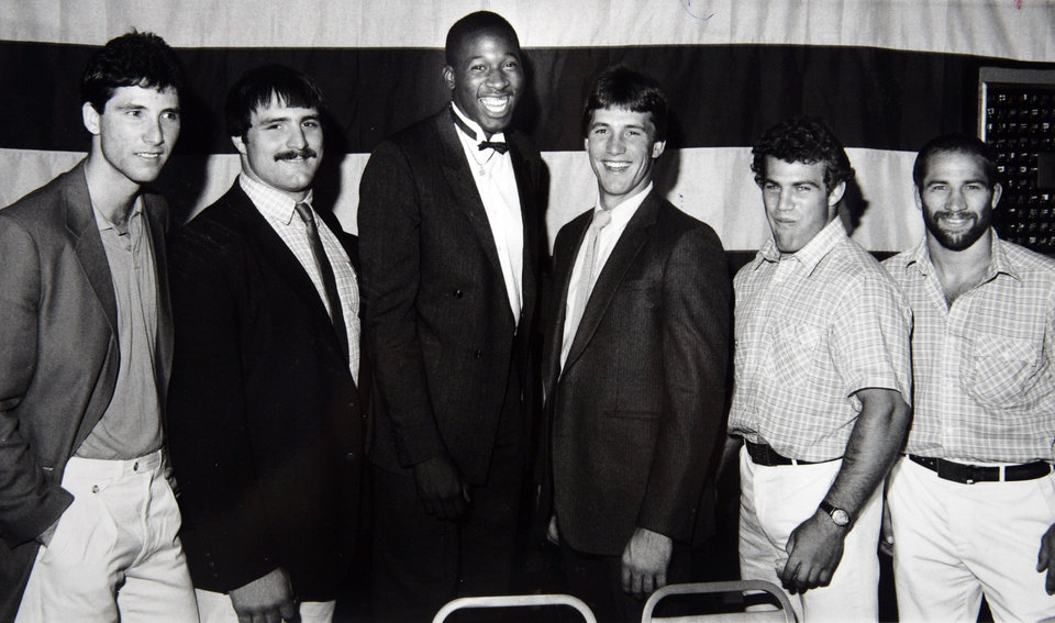 Former OU basketball player Wayman Tisdale. Six Oklahoma Olympic athletes get together prior to a banquet honoring them Thursday night. They are, from left, Gary Green Bruce Baumgartner, Wayman Tisdale, Bobby Witt, Mark Schultz and Dave Schultz. A seventh, gymnast Bart Conner, was unable to attend. Staff Photo by George R. Wilson. Photo taken 9/6/1984, photo published 9/7/1984 in The Daily Oklahoman ORG XMIT: KOD